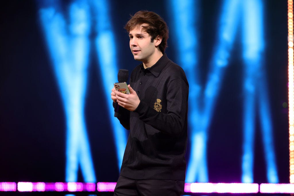 David Dobrik speaks onstage during Nickelodeon's Kids' Choice Awards March 13 at Barker Hangar in Santa Monica, California. (Photo by Rich Fury/KCA2021/Getty Images for Nickelodeon)