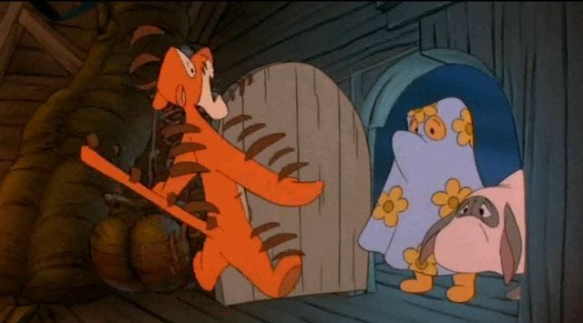 screenshot of frightened Tigger opening the door to see Pooh dressed as a ghost