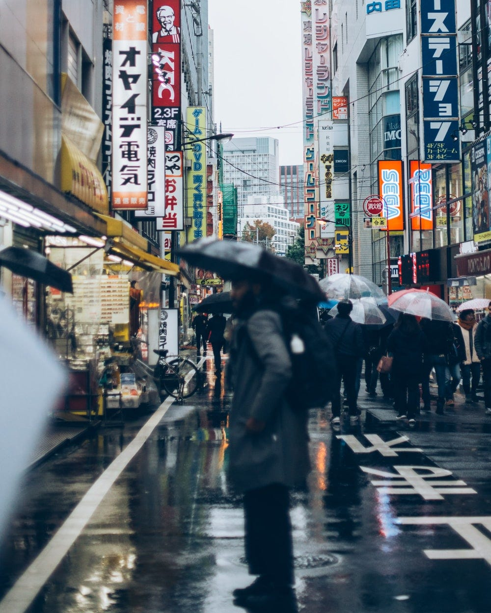 view photography of people walking between buildings during daytime