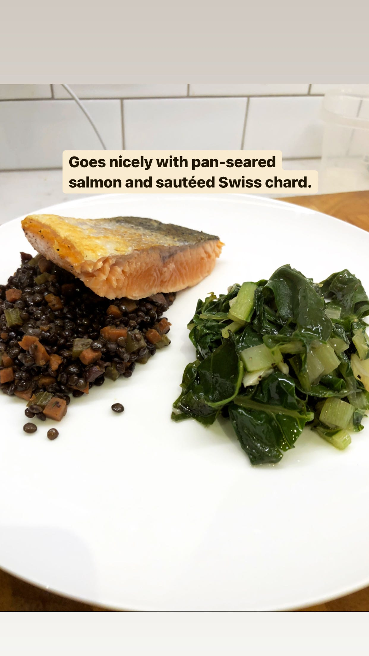 Lentils served with salmon and Swiss chard