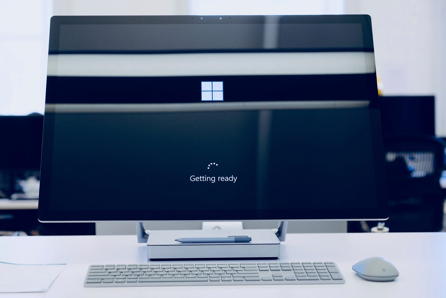 Photo of a Windows PC with a monitor with display text reading 'Getting ready'. Johny Vino / Unsplash