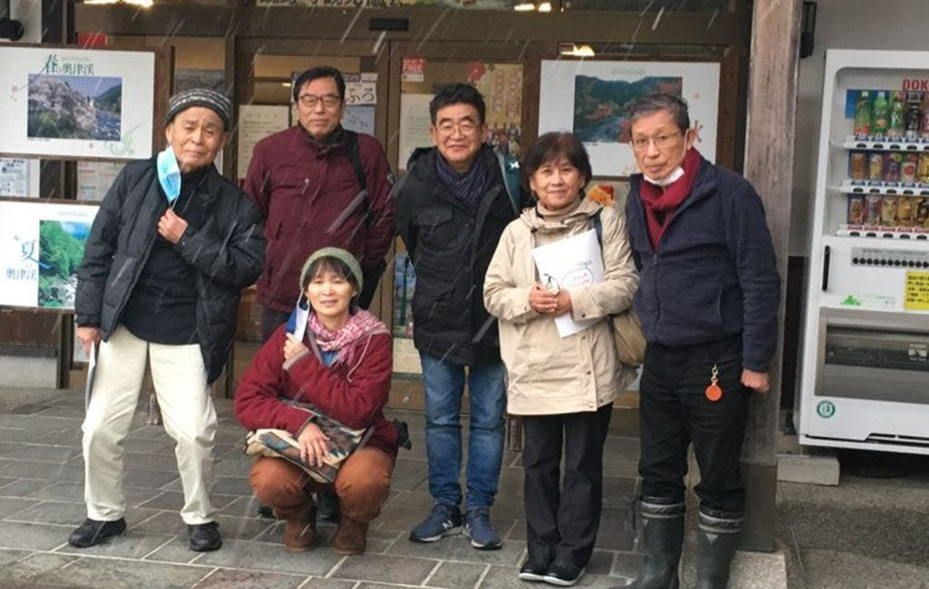 (Courtesy of Tomoyo Tamayama) Activists pose for a photo before their visit to a Japan Atomic Energy Agency site in southern Japan that plans to ship radioactive material to Utah for processing. Tomoyo Tamayama (below)  researched the legacy of uranium mining on the Navajo Nation in two postgraduate programs.