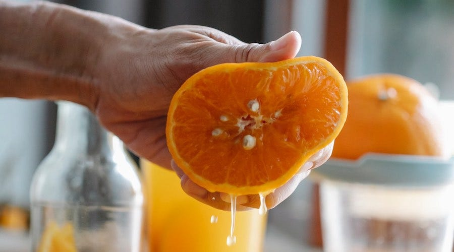 Squeezing juice from an orange
