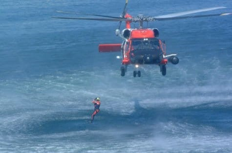 SEATTLE (Aug. 8, 2004) A rescue swimmer jumps from an HH-60 Jayhawks helicopter, from Coast Guard AIr Station Astoria, Ore., during a rescue drill performed for federal and state officials. USCG photo by PA3 Adam Eggers.
