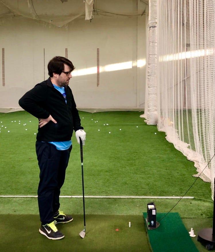 Elliott hitting golf balls