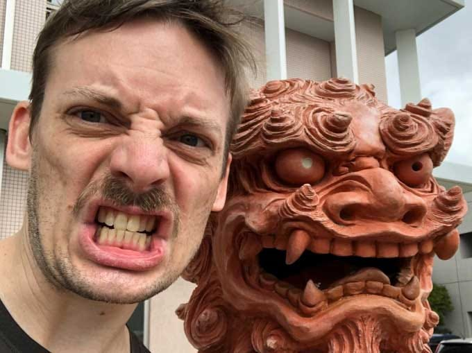 Andy Fossett poses with a Shisa in Okinawa