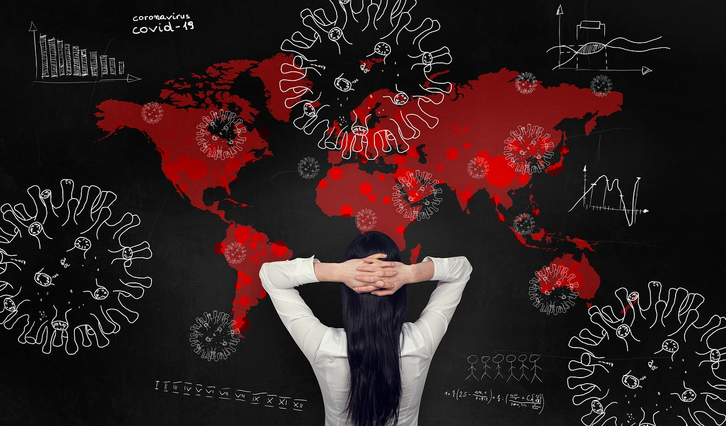 Woman with hands on head in despair, facing a red, world map with viruses floating around.