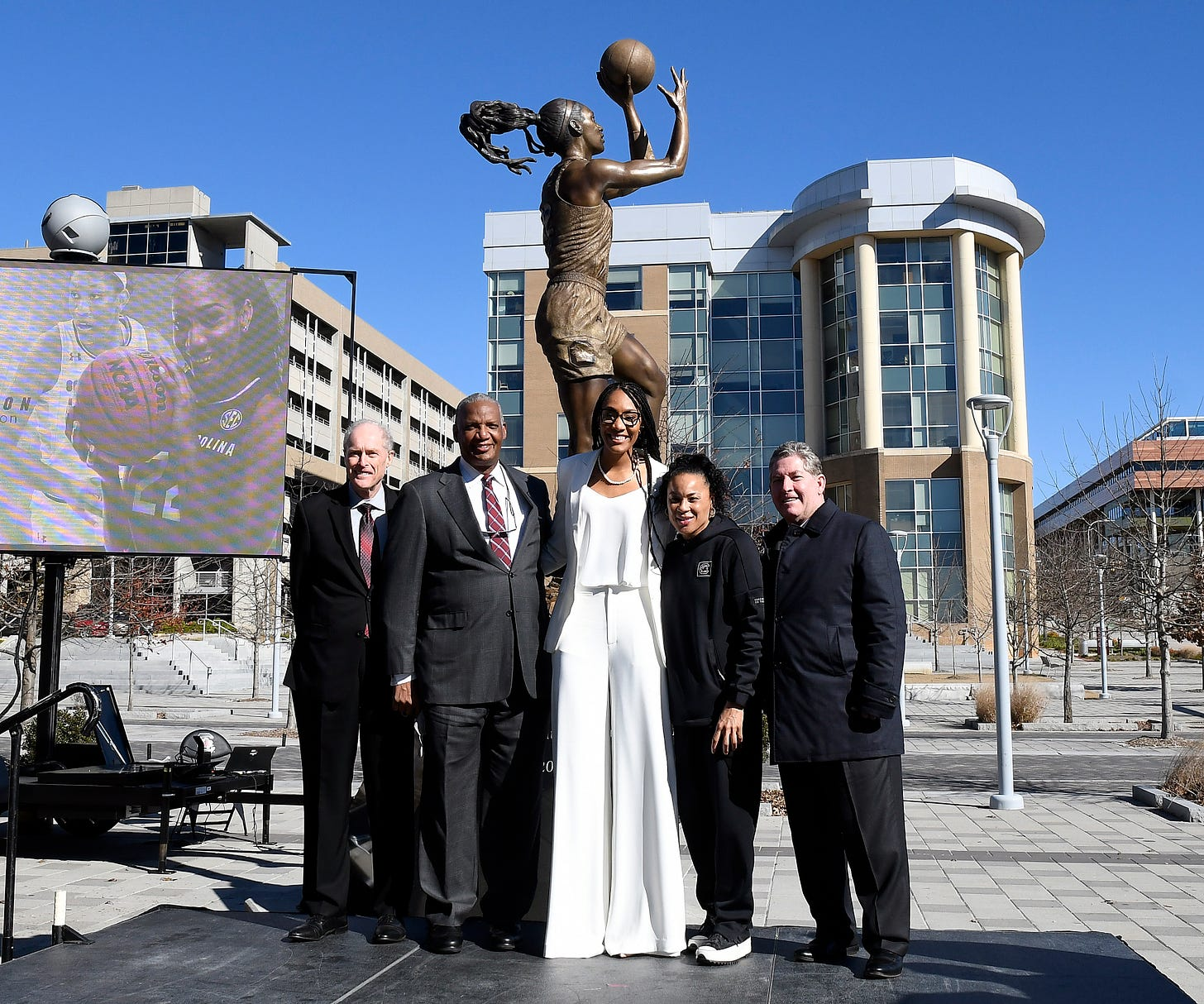 A'ja Wilson, Dawn Staley and others in front of forever A'ja. (Photo courtesy of South Carolina Athletics)