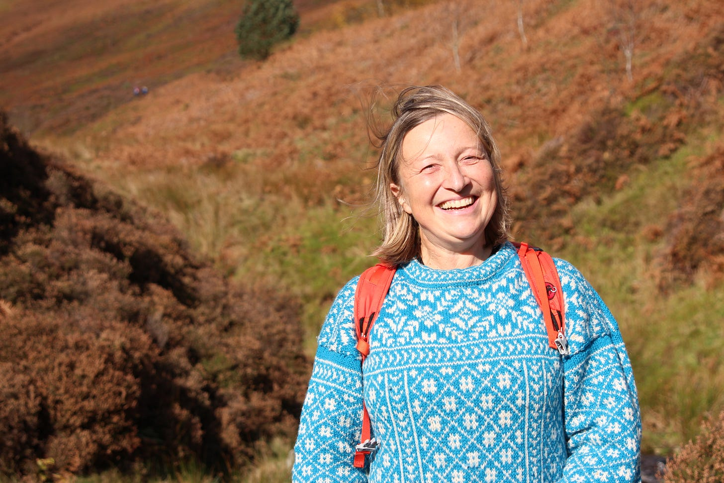 Helen Turton standing next to Grindsbrook in Edale