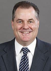 Commissioner Bill Robertson - Western Collegiate Hockey Association