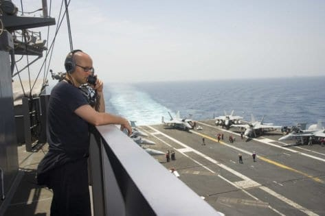 160724-N-QN175-011 ARABIAN GULF (July 24, 2016) – Seaman Kelcey Woodward mans the aft lookout watch station on vulture's row of the aircraft carrier USS Dwight D. Eisenhower (CVN 69) (Ike). Ike and its Carrier Strike Group are deployed in support of Operation Inherent Resolve, maritime security operations and theater security cooperation efforts in the U.S. 5th Fleet area of operations. (U.S. Navy photo by Mass Communication Specialist Seaman Dartez C. Williams/Released)