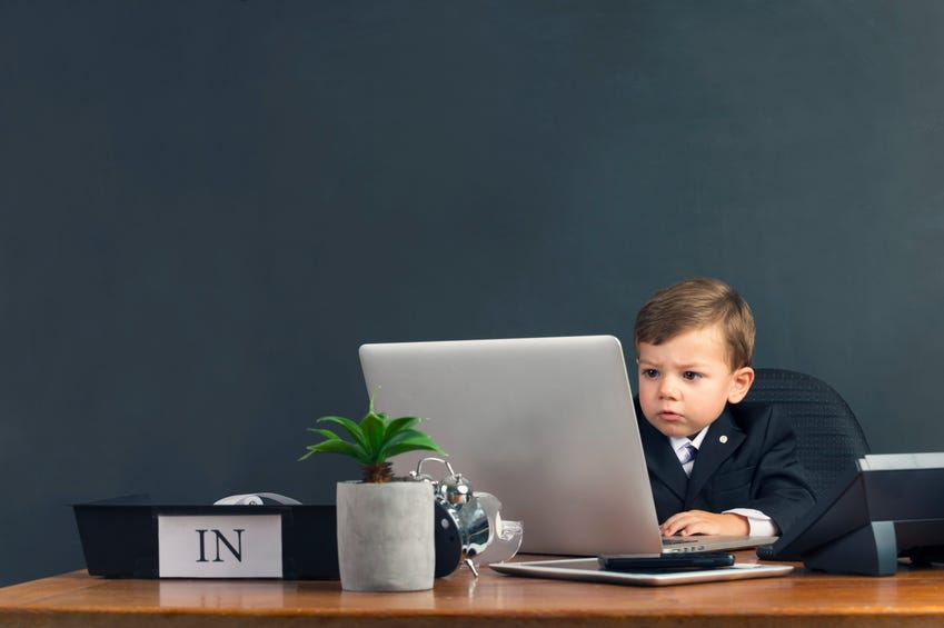 Humorous image of young boy working on a laptop computer   Jobs at  Enterprise Rent-A-Car