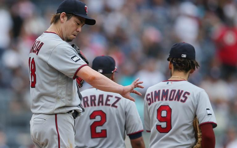 Minnesota Twins starting pitcher Kenta Maeda (18) looks at his arm following a conference on the mound during the fifth inning against the New York Yankees on Saturday, Aug. 21, 2021, at Yankee Stadium. Brad Penner / USA Today Sports