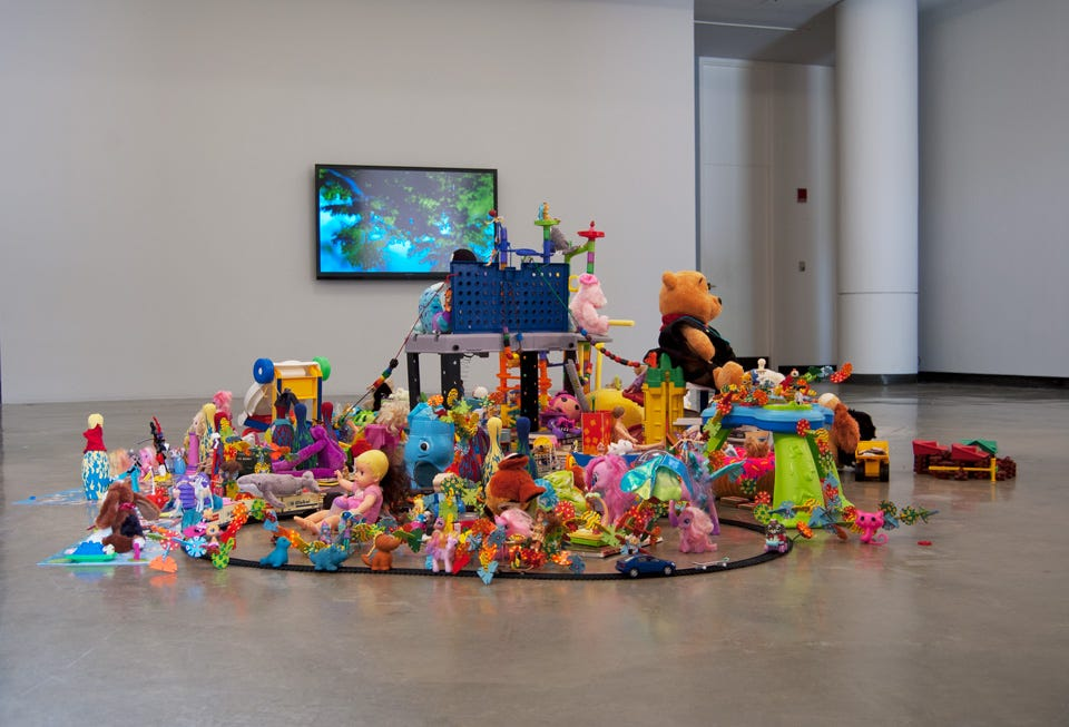 Donated toys piled up in the middle of a room