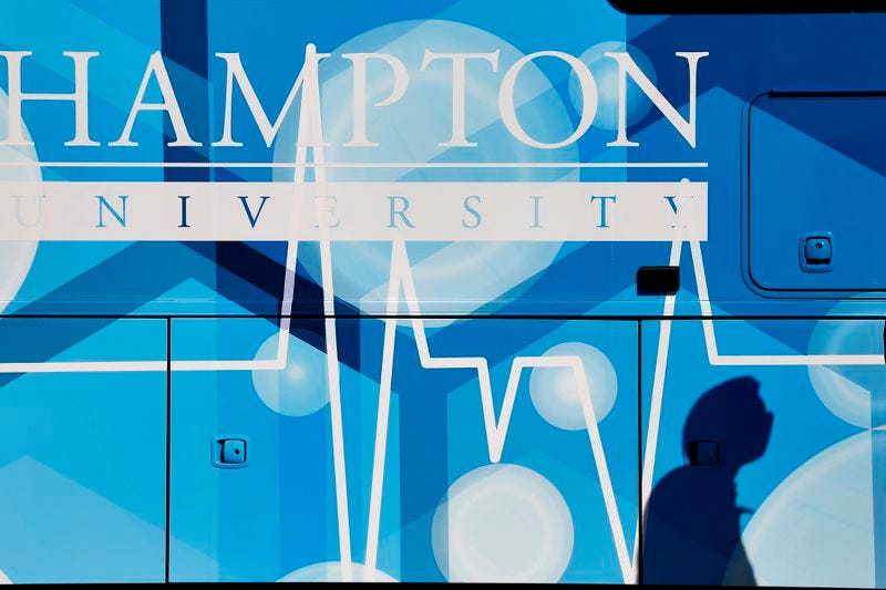 A man walks past an upgraded RV that Hampton University will use as COVID-19 testing and vaccination site during a press conference Thursday afternoon February 25, 2021. Hampton University is also partnering with the Hampton VA Medical Center to use the Convocation Center as a vaccination site starting March 8.