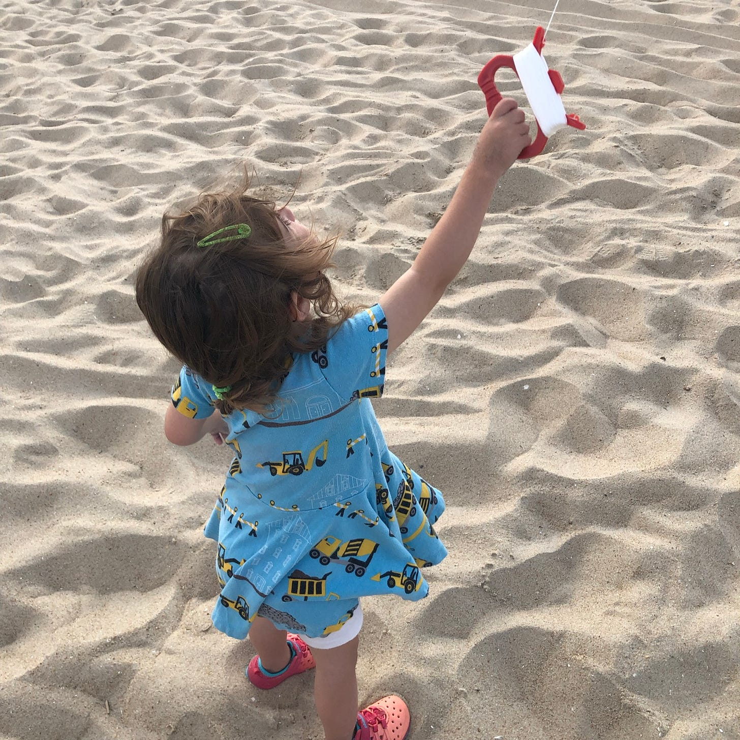 Photo shows Lila flying a kite.