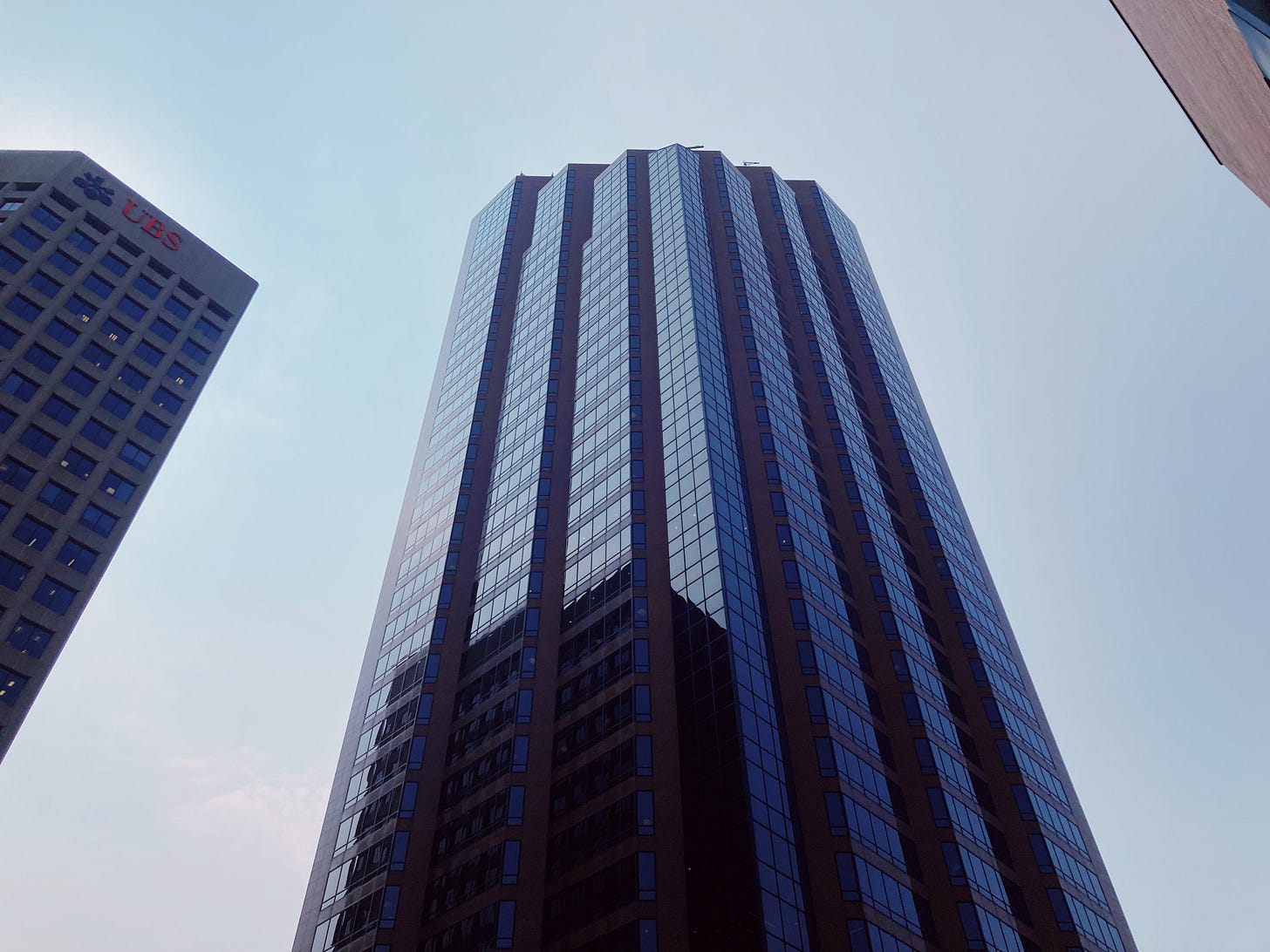 high rise wells fargo place building in st paul, glass reflects the clear blue sky