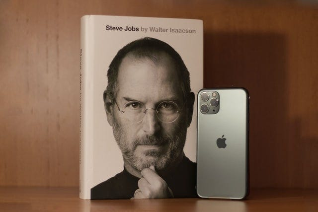Steve Jobs book and apple iphone image