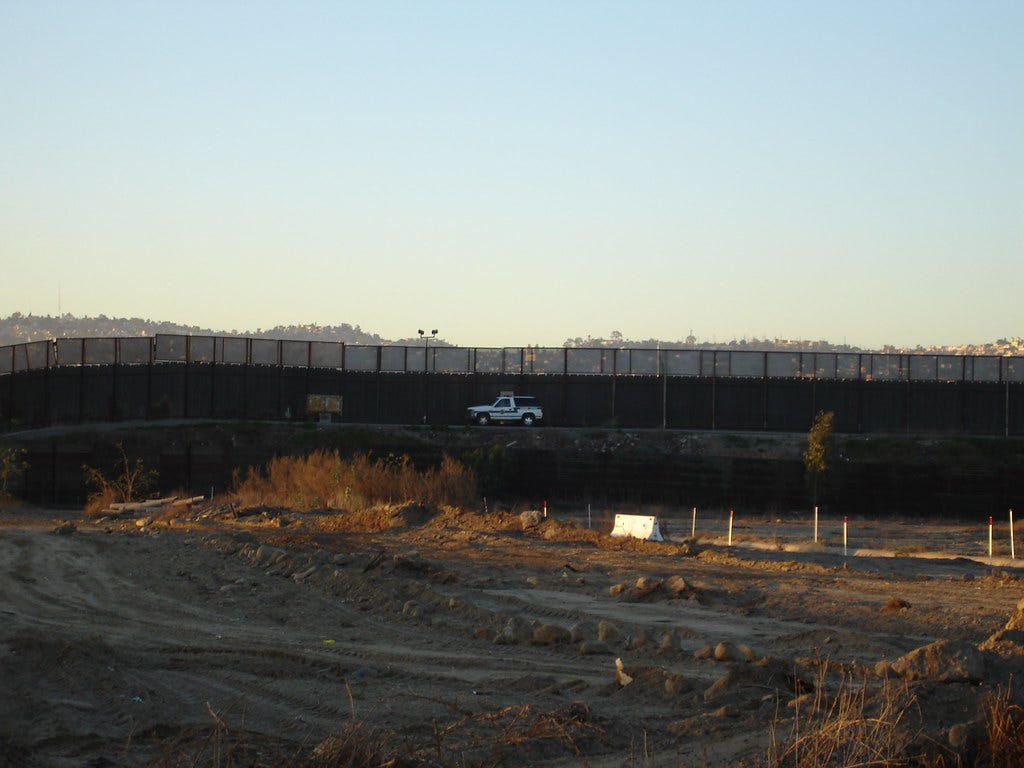 """""""Border Fence"""" by pearlbear is licensed under CC BY 2.0"""