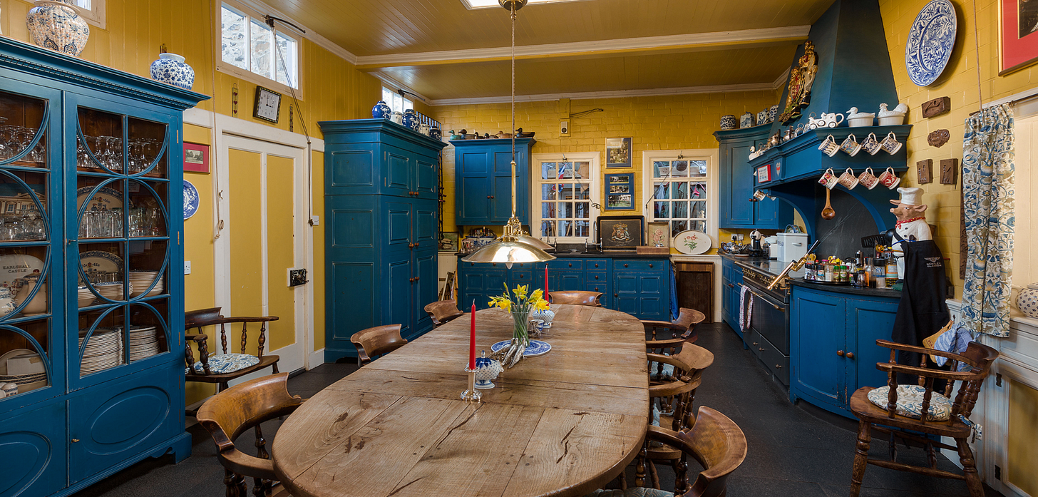 An incredible yellow and blue kitchen in Earlshall castle