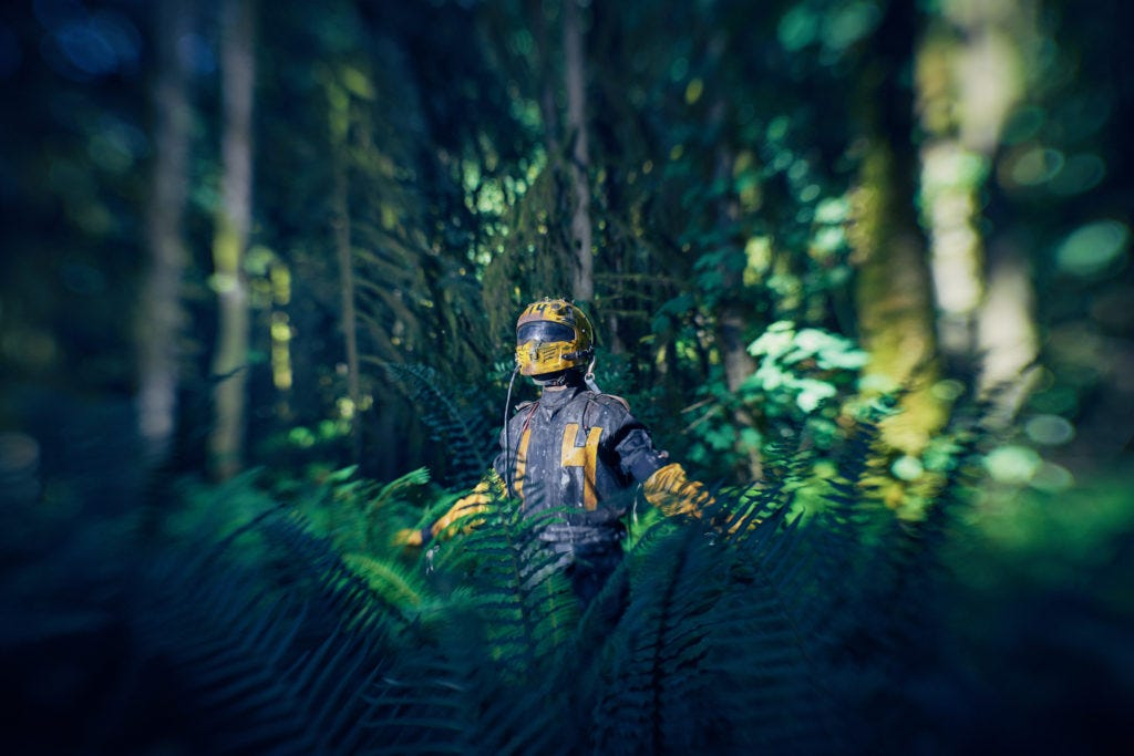 A lost inmate from an apocalyptic jail wanders the forest wearing a yellow helmet