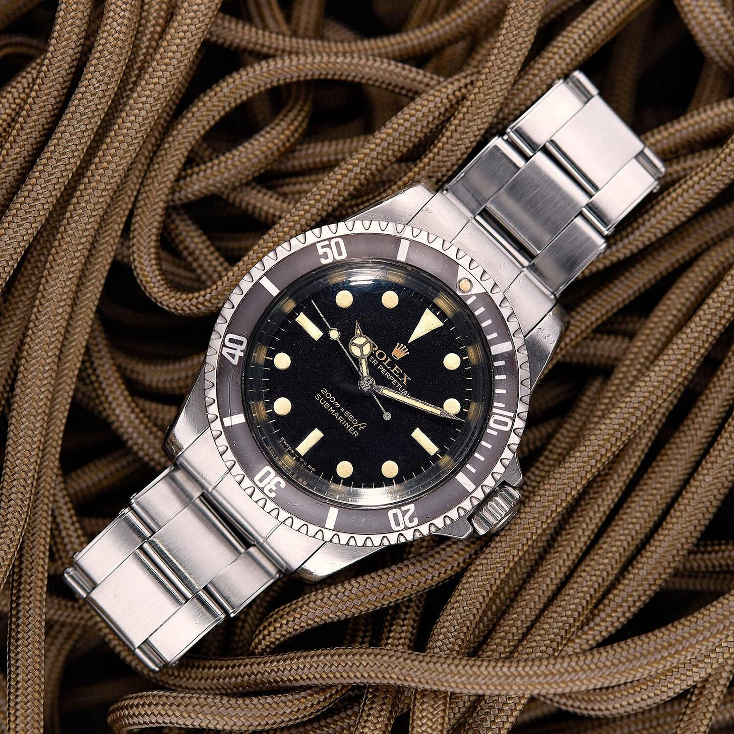 """A gilt dial reference 5513 """"Bart Simpson"""". The 5513 in particular illustrates the evolution of the Submariner form the 60s through the 80s, starting with these glossy gilt dials, and ending with the glossy black dials of the 1980s. 