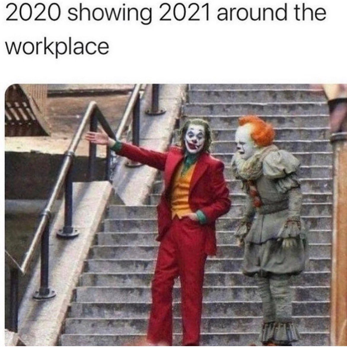 Joaquin Phoenix as The Joker points something out to Pennywise the Clown. Caption: 2020 showing 2021 around the workplace.