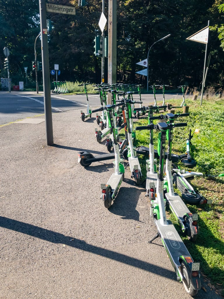 """""""Lime electric scooters in Cologne, Germany"""" by dronepicr is licensed under CC BY 2.0"""