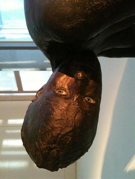 Haunting sculpture of a woman looking to the side, uneasy