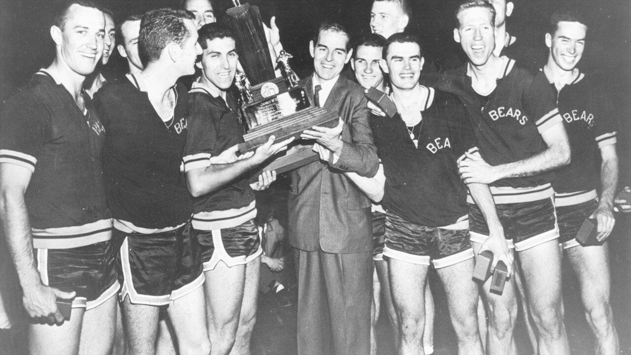 Pete Newell and his players pose with the 1959 National Championship Trophy after beating Oscar Robinson and then Jerry West.