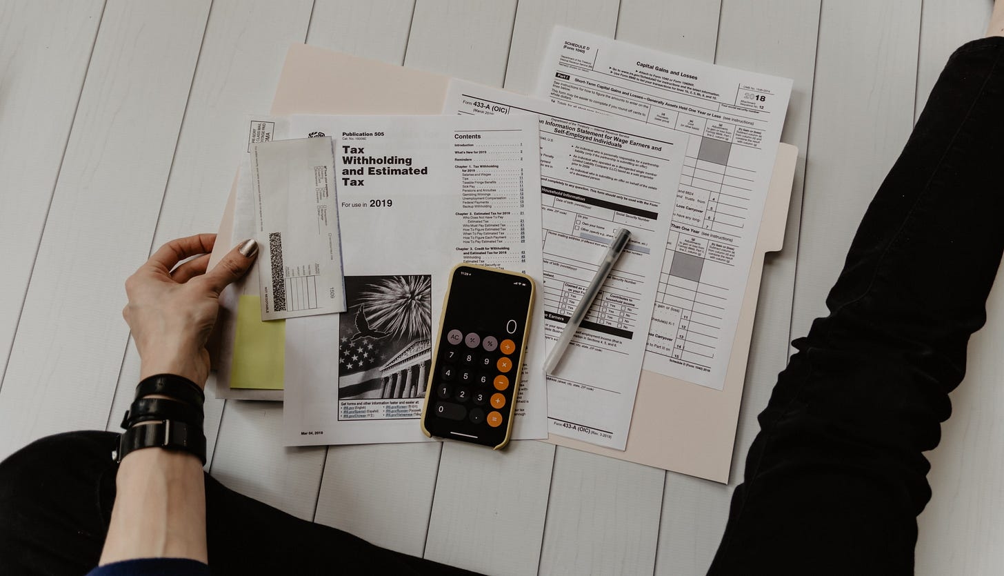 """Image of a self-employed person business documents laid out for article titled """"9 Reasons Why You Need To Be Self-Employed"""""""