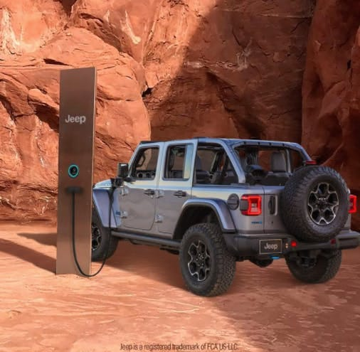 electric jeep filling up at the Utah Monolith