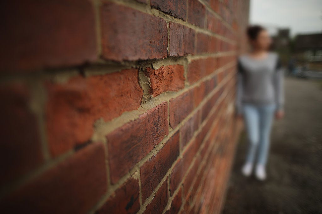 A teenage girl, who claims to be a victim of sexual abuse and alleged grooming, poses in Rotherham on September 3, 2014 in Rotherham, England. South Yorkshire Police have launched an independent investigation into its handling of the Rotherham child abuse scandal and will also probe the role of public bodies and council workers. A report claims at least 1,400 children as young as 11 were sexually abused from 1997- 2013 in Rotherham. (Photo by Christopher Furlong/Getty Images)