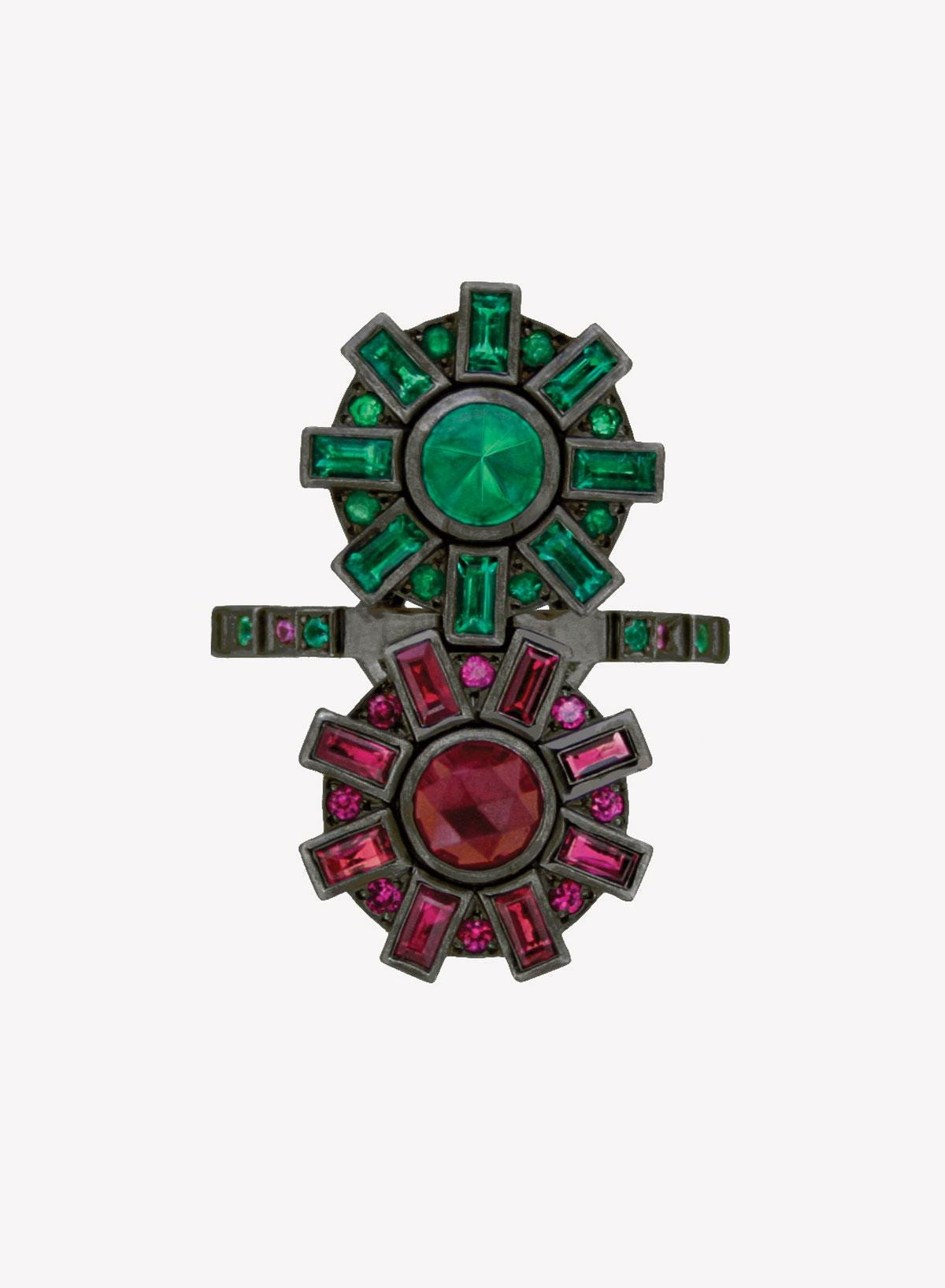 ruby and emerald cogs ring against a white background