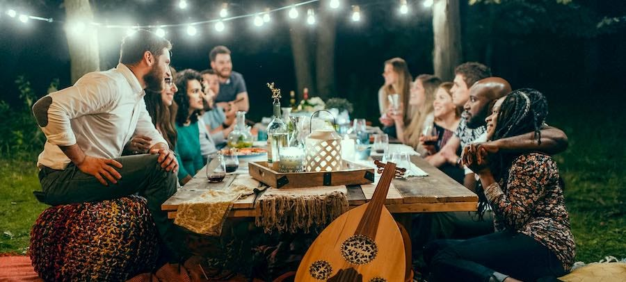 Group dinner in backyard at night