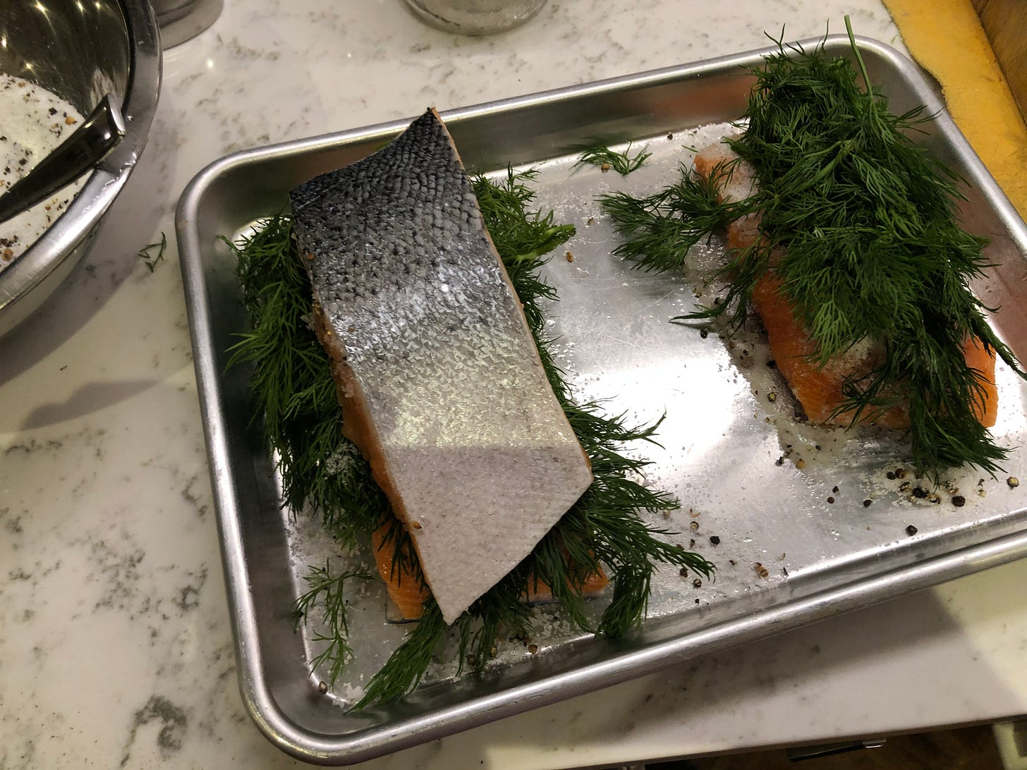 One piece of salmon on top of another.