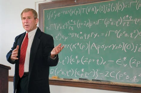 George W. Bush stands in front of a chalkboard filled with mathematical equations.