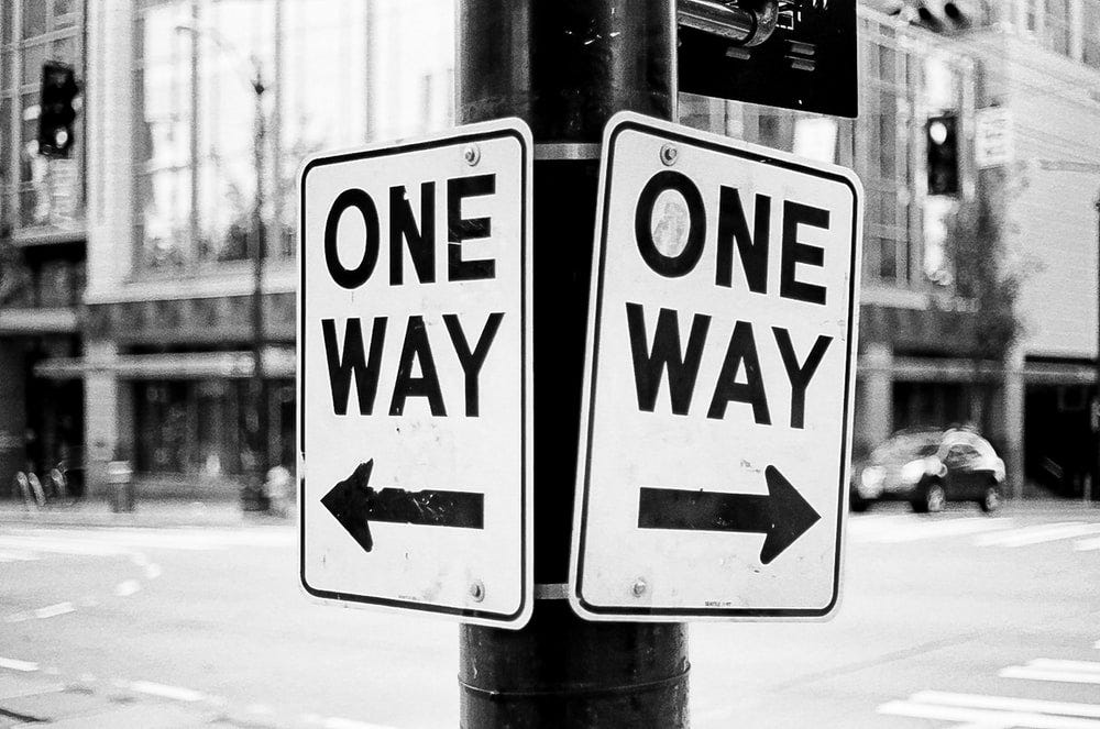 2 one-way signs point at opposite directions