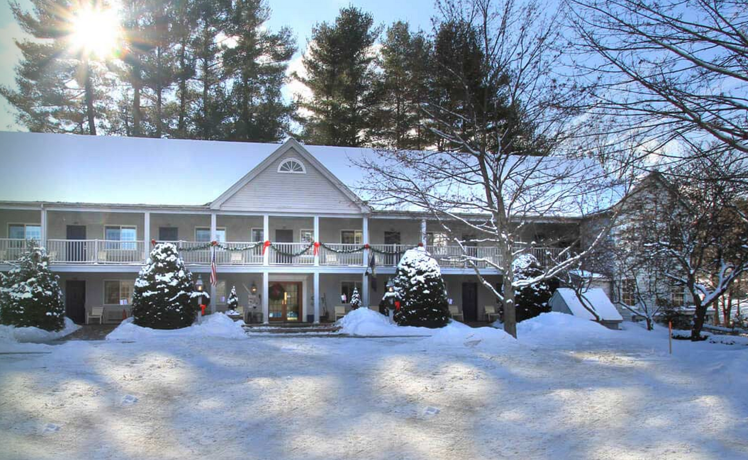Photo of quaint hotel snow covered.