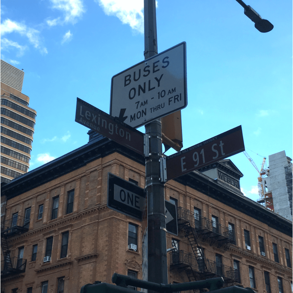 Street signs at the intersection of Lexington Avenue and 91st Street in Manhattan.