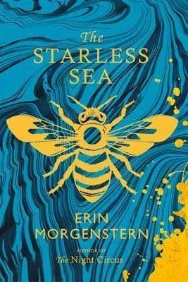 """Cover of The Starless Sea—Swirling blue & black background with a yellow bee """"stamp"""""""
