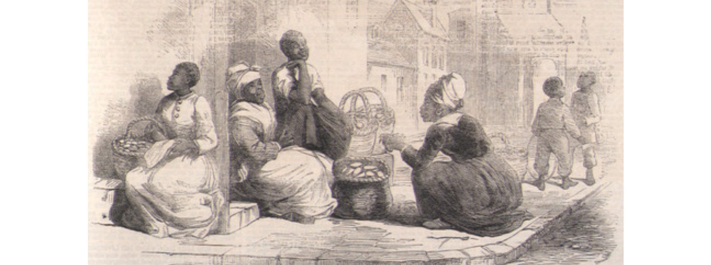 Women sitting with bags of vegetables