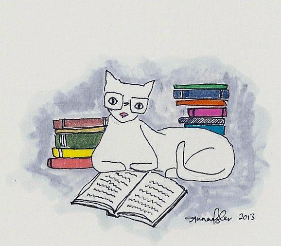 cat reading books | Lev Hardware