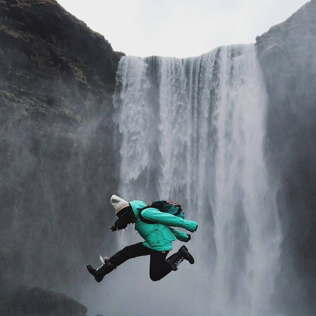 women jumping over a cliff