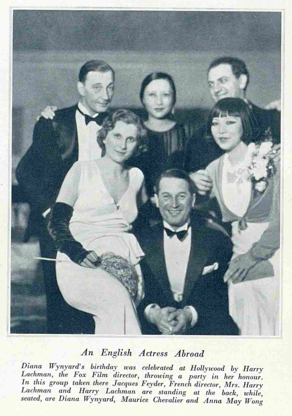 clipping from The Bystander, black and white photo of the Lachmans, Diana Wynyard, and other guests at a party