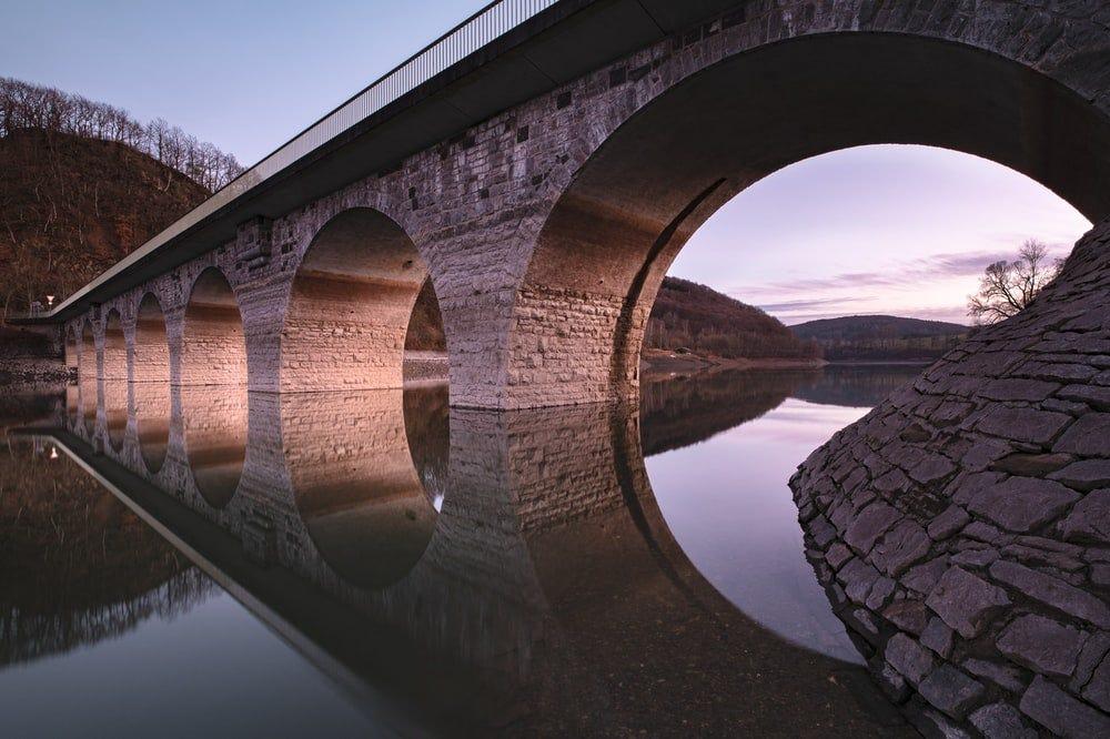 brown concrete bridge over river during daytime