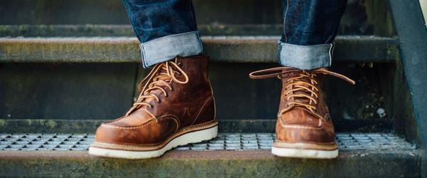 red wing moccasin boots on some rusty metal stairs