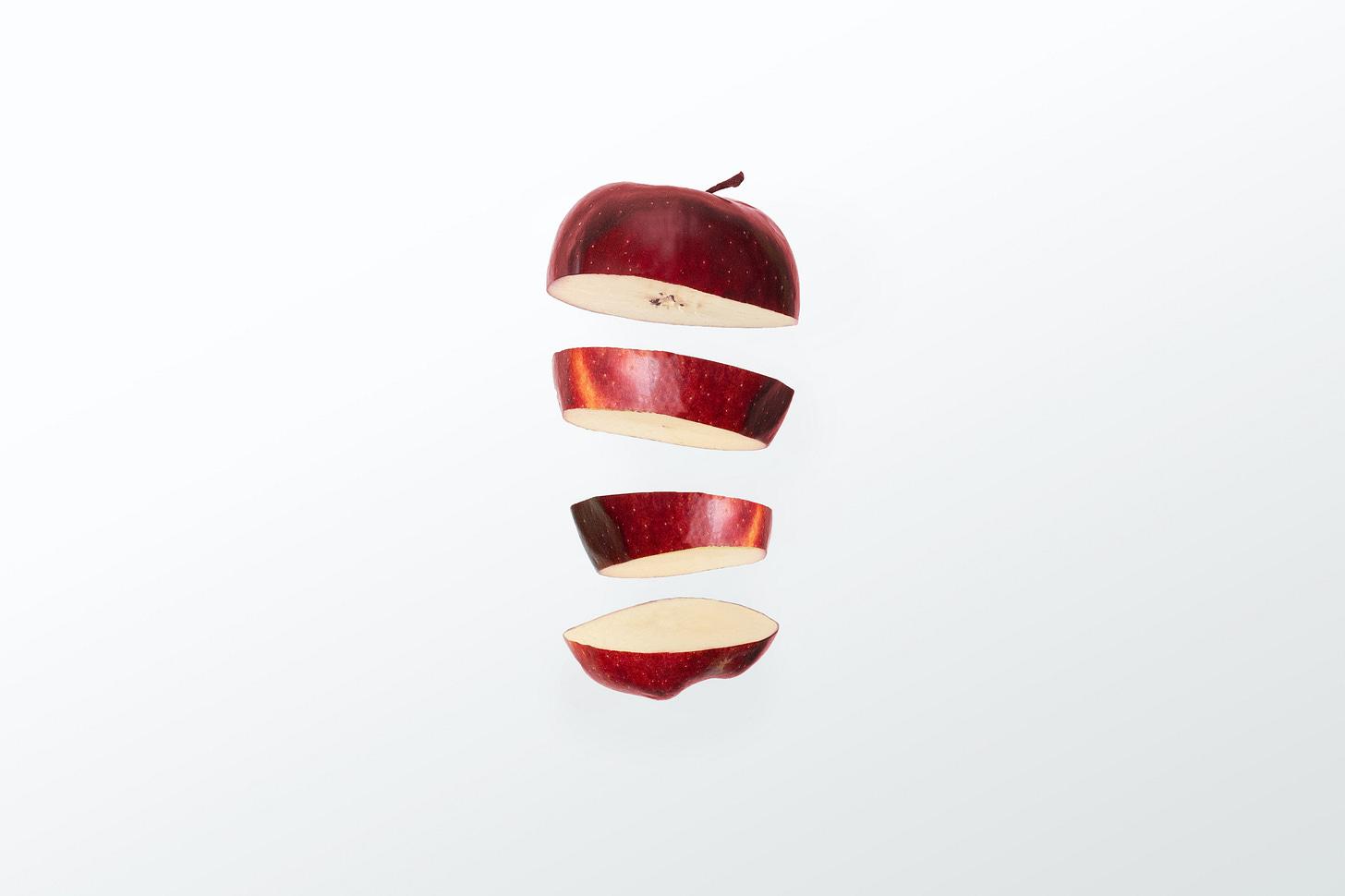 Photo of an Apple in slices. By Nikolai Chernichenko / Unsplash