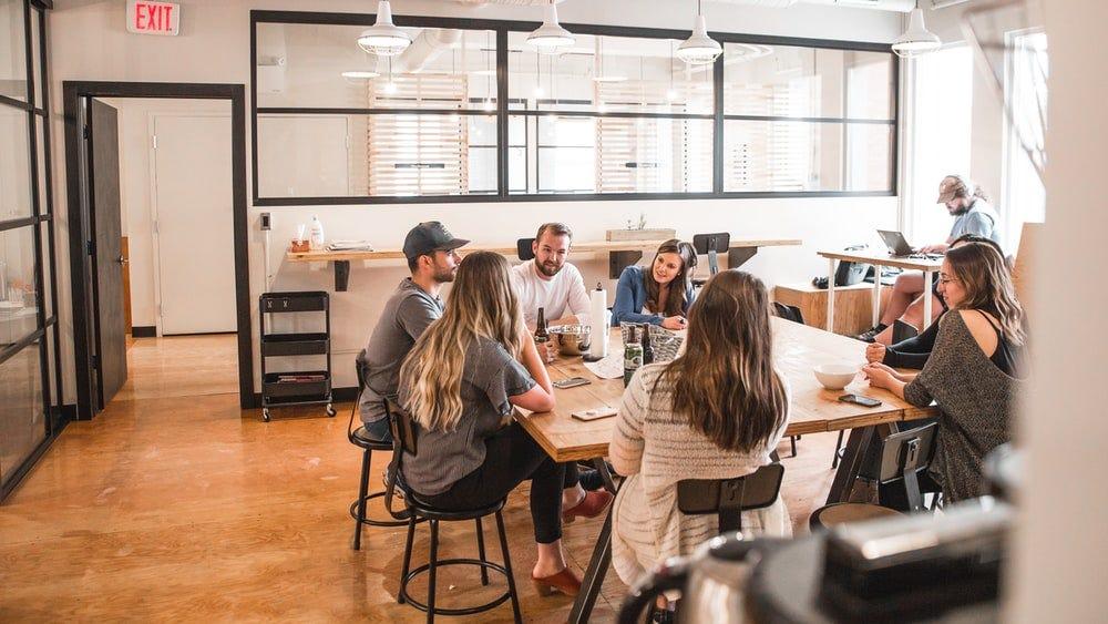 talking people sitting beside table