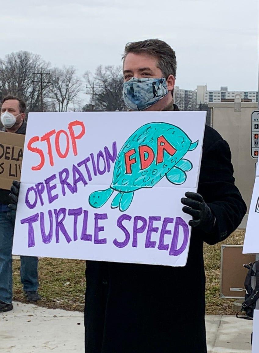 John protesting outside the FDA